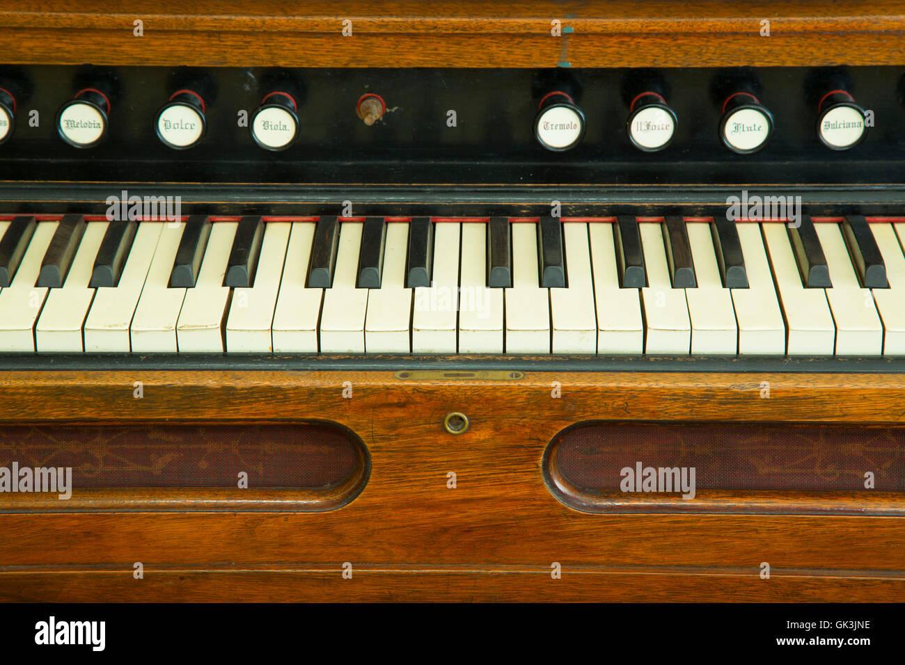 Pump organ keyboard, Shoshone County Mining & Smelting Museum at the Staff House, Kellogg, Idaho - Stock Image