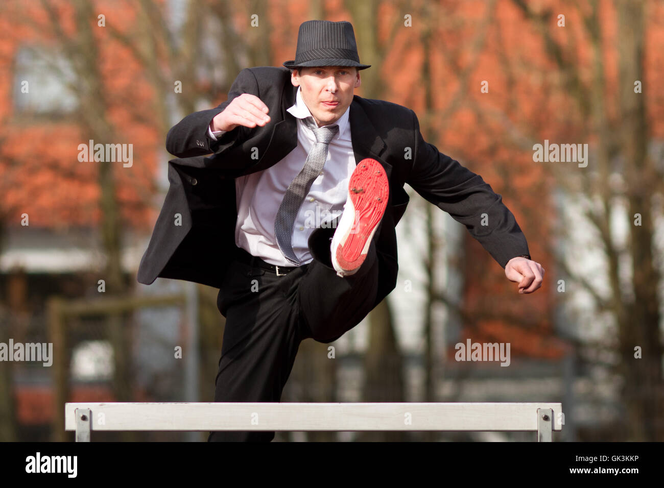 businessman overcomes all obstacles - Stock Image
