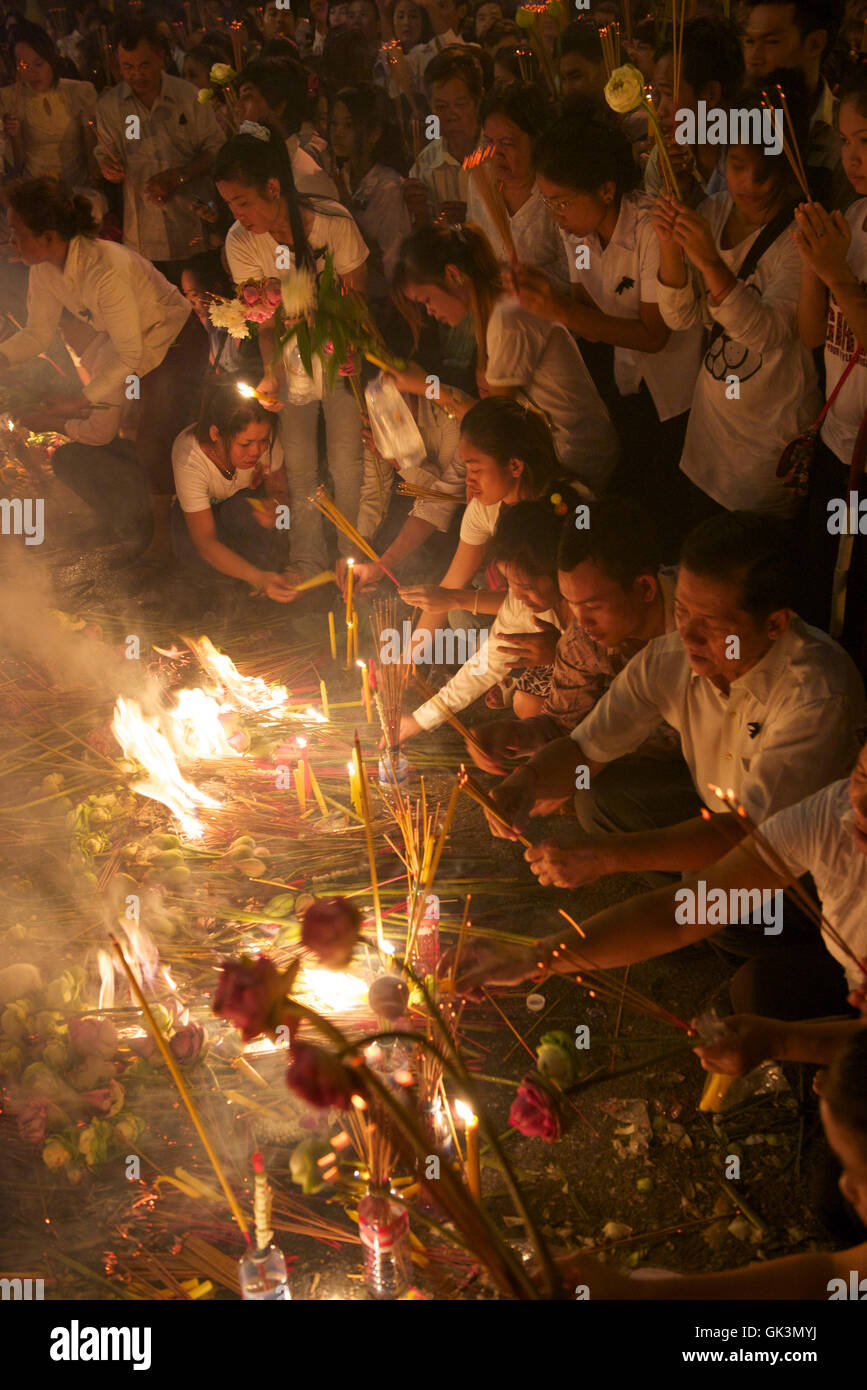 Phnom Penh, Cambodia --- Mourners gather for a week, burning incense and displaying portrait of King Norodom Sihanouk, Stock Photo