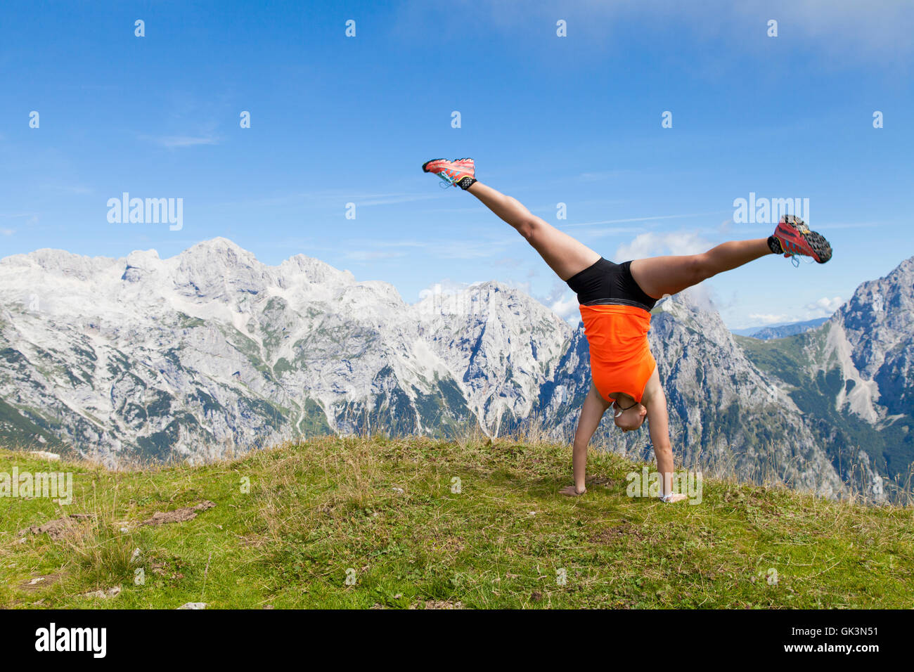 Pretty women joyfully jumping and performing cartwheel - Stock Image