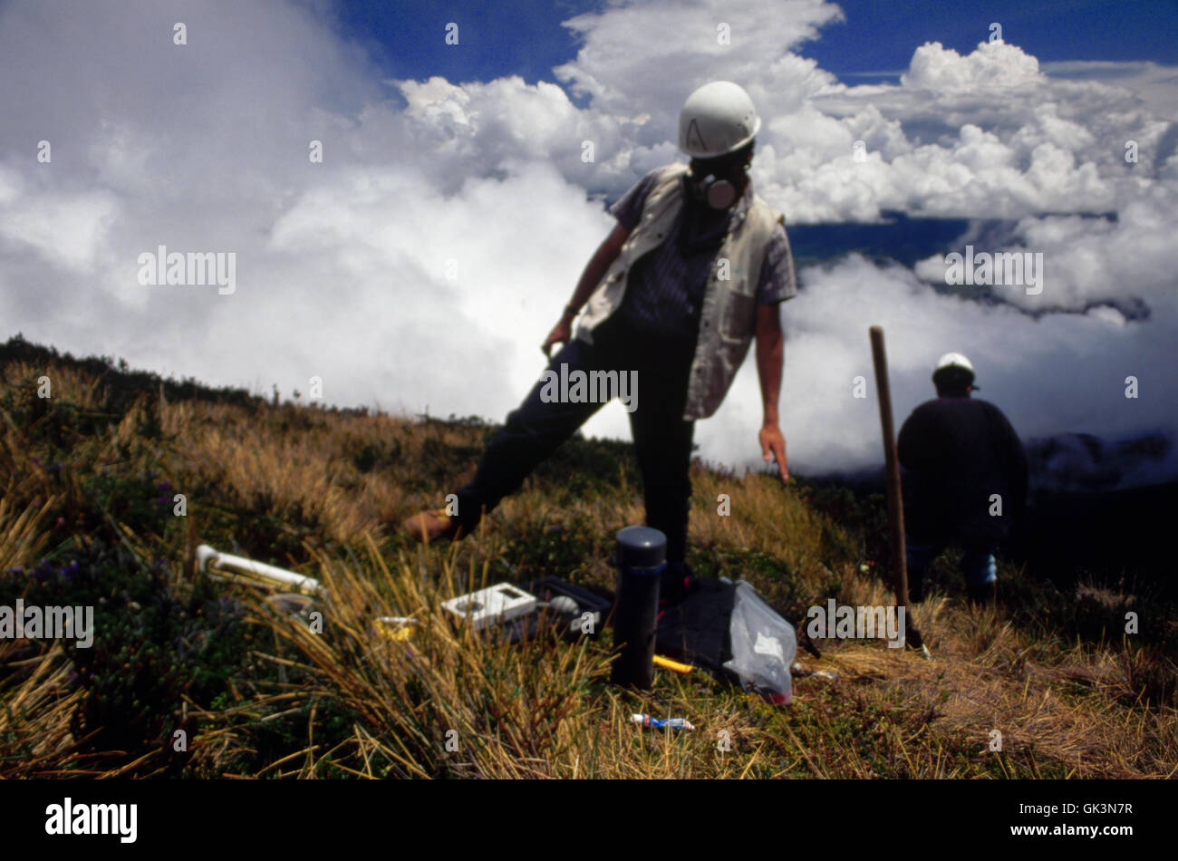 ca. 1980-1995, Pasto, Colombia --- A volcanologist measures the radon gas levels of Galeras volcano, Pasto, Colombia. - Stock Image