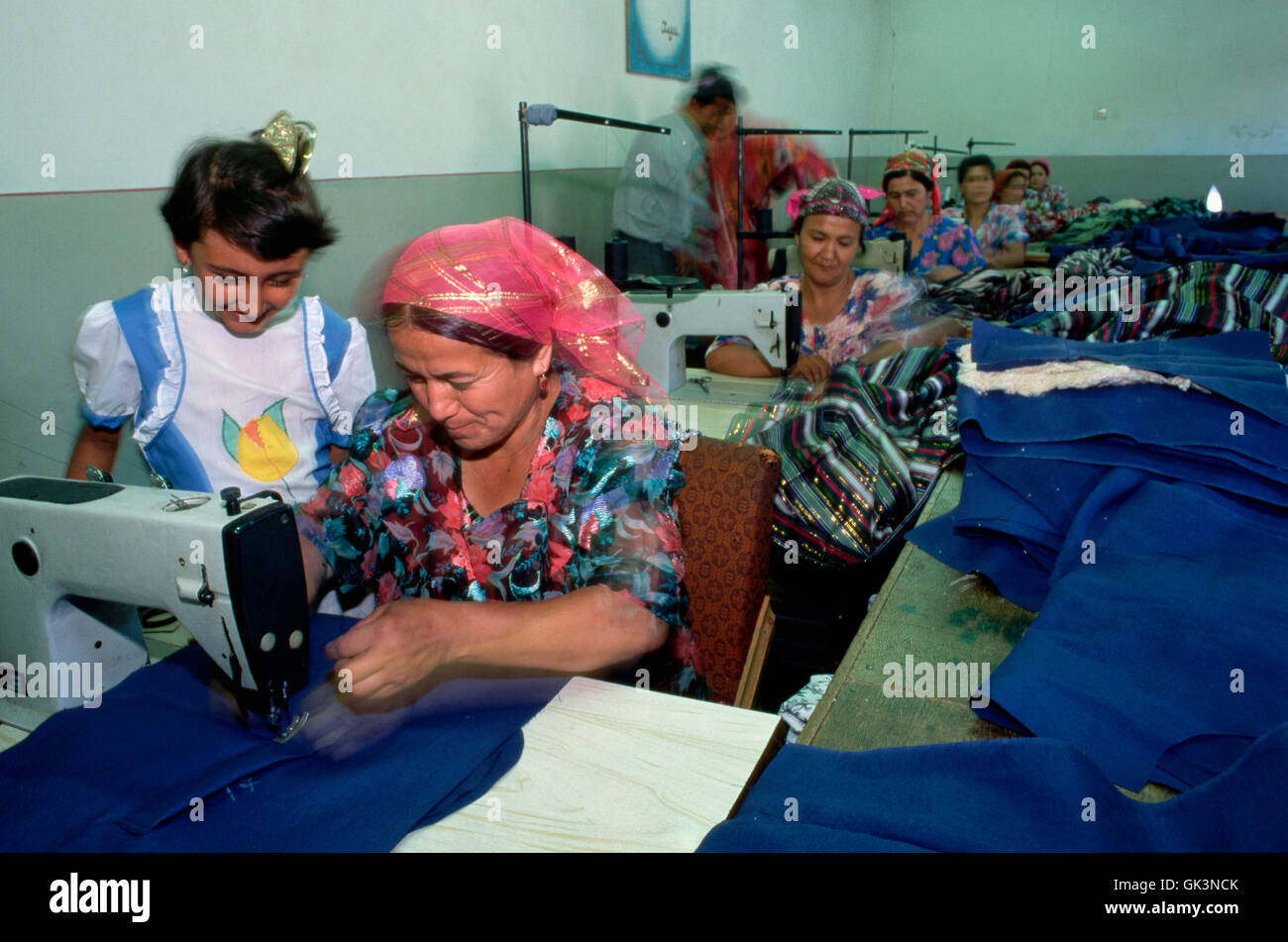 ca. 1980-1997, Marghilon, Uzbekistan --- Seamstresses make clothing in a factory sewing room. --- Image by © - Stock Image