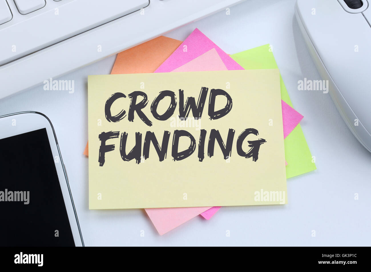 Crowd funding crowdfunding collecting money online investment internet business concept desk computer keyboard - Stock Image