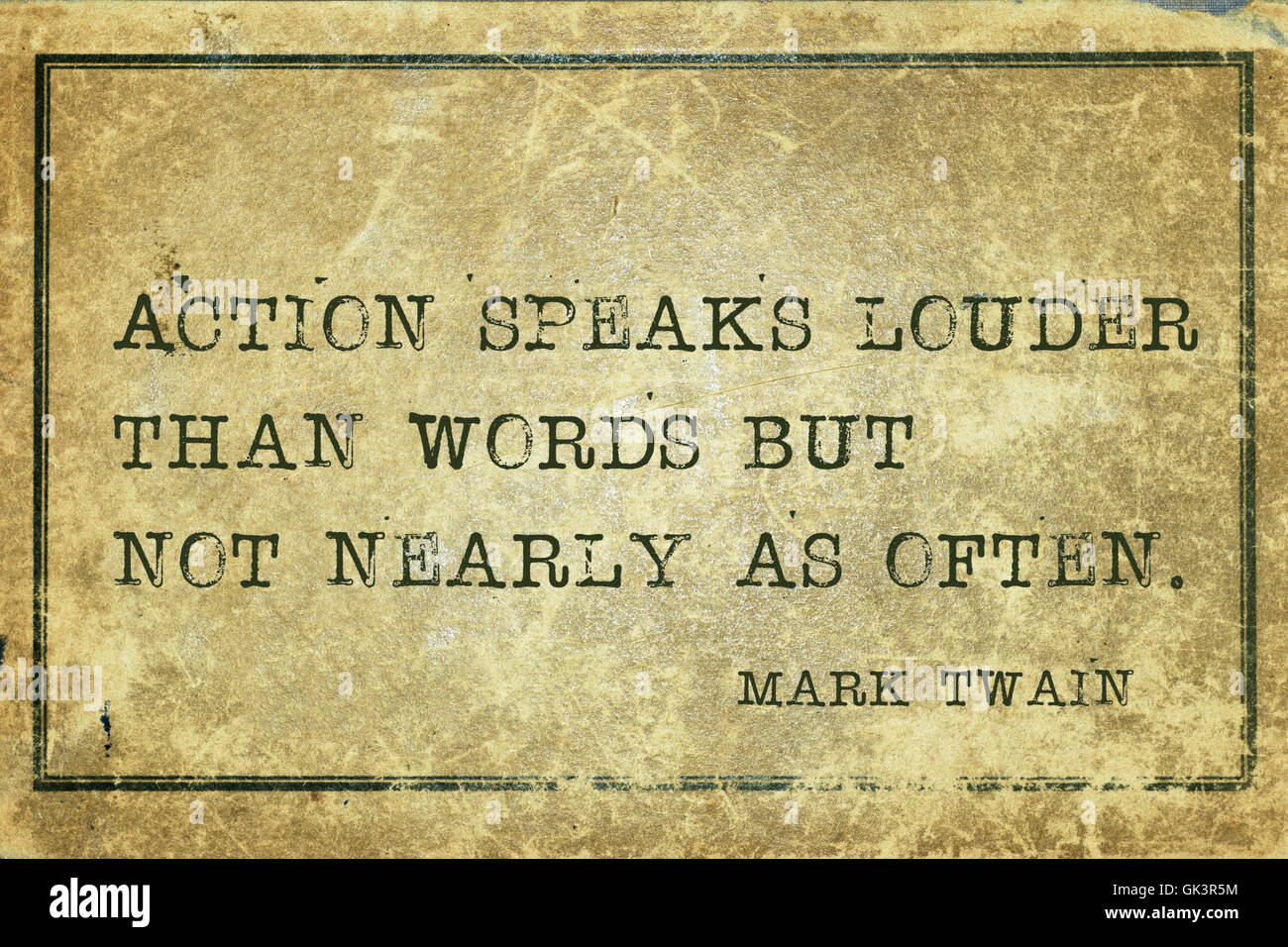 Action speaks louder than words -  famous American writer Mark Twain quote printed on grunge vintage cardboard Stock Photo