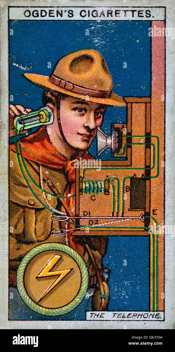 Ogden's cigarette card of a boy scout using a telephone - Stock Image
