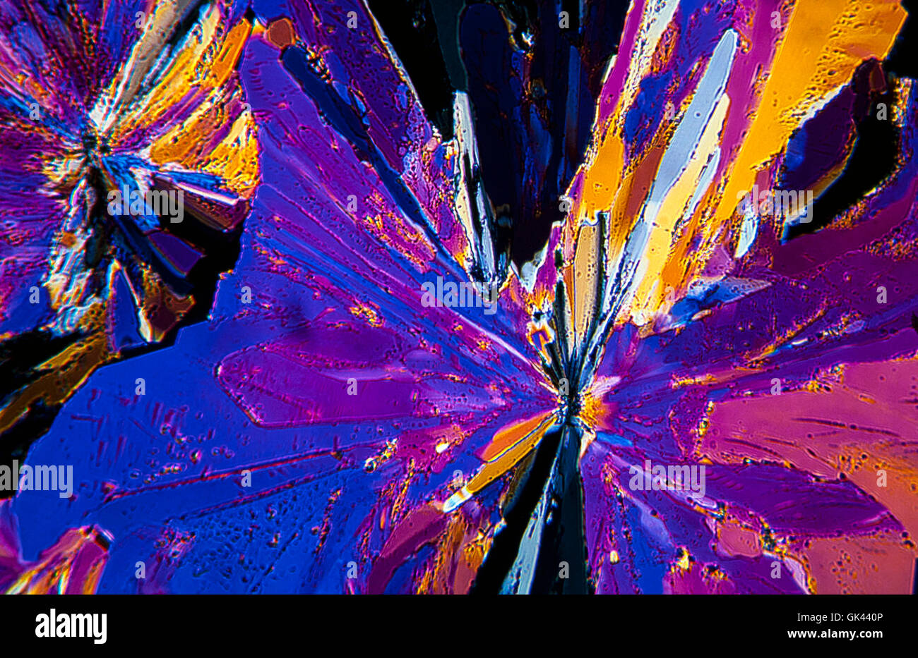 Sulfur crystals photomicrography with polarized light. Portugal Stock Photo
