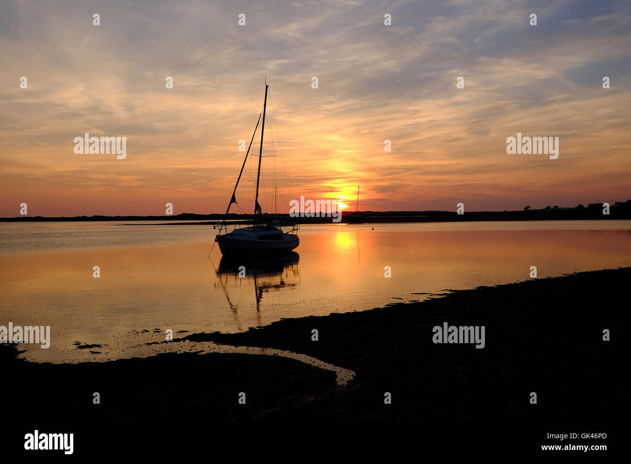 boat at sunset on River Esk at Ravenglass - Stock Image