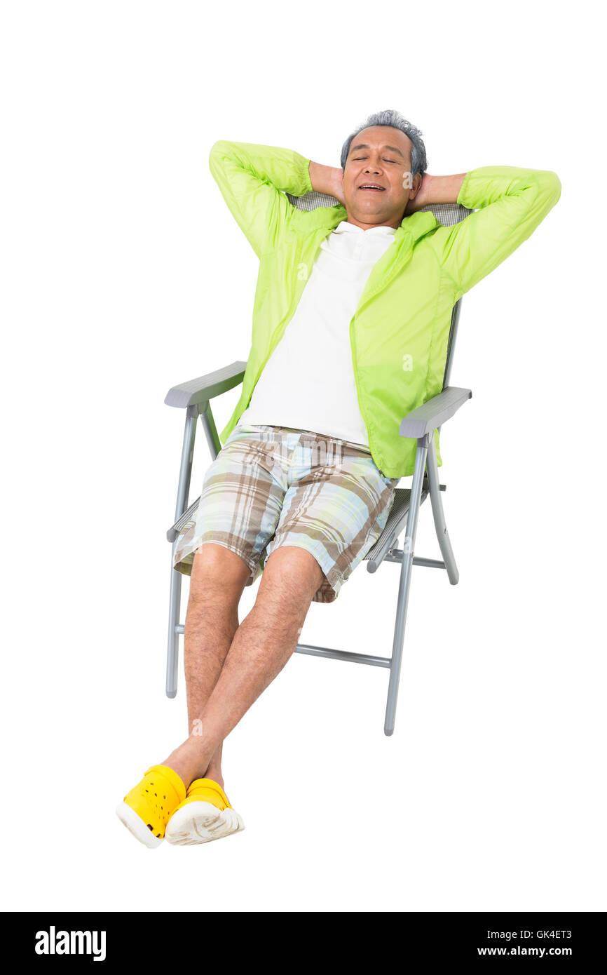 Elderly Man Sitting On A Beach Chair Stock Photo Alamy