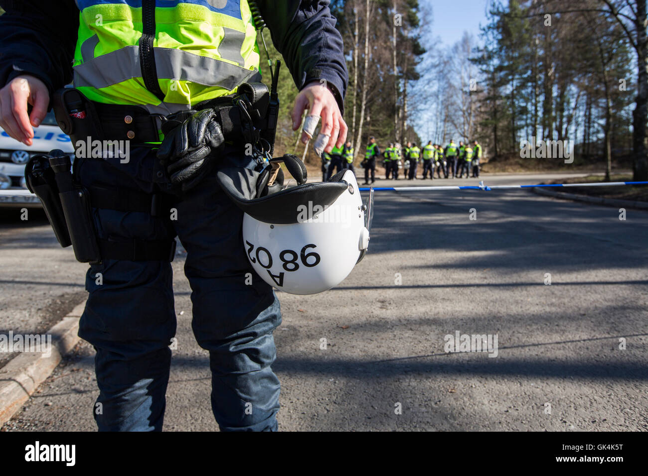 Riot police are prepared before a demonstration. - Stock Image