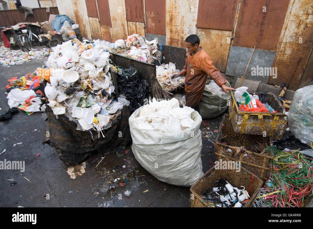 2005, Beijing, China --- Recycler Sorting Garbage --- Image by © Jeremy Horner - Stock Image