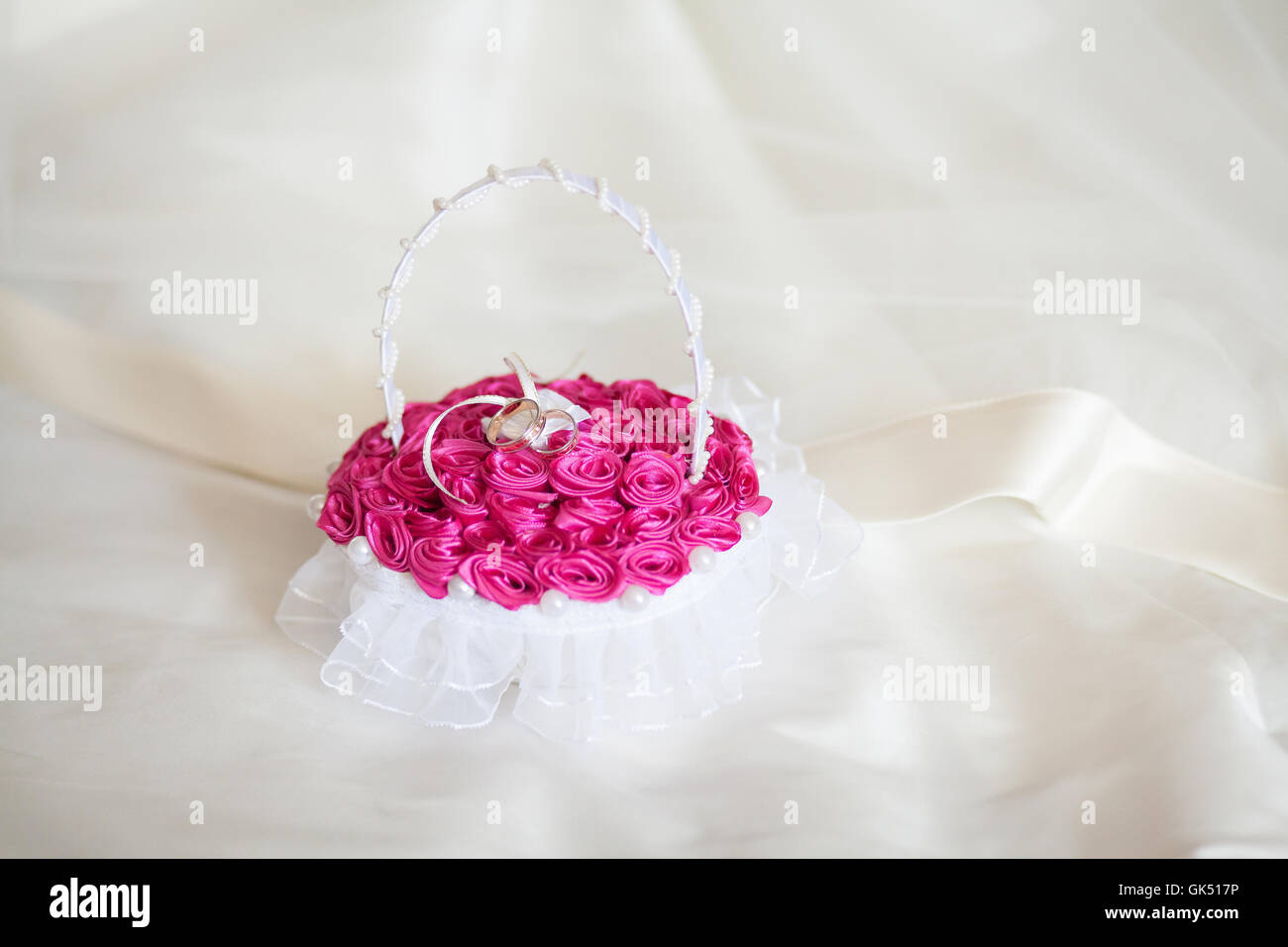 Golden wedding rings on decorated little purple pillow. Marriage ...