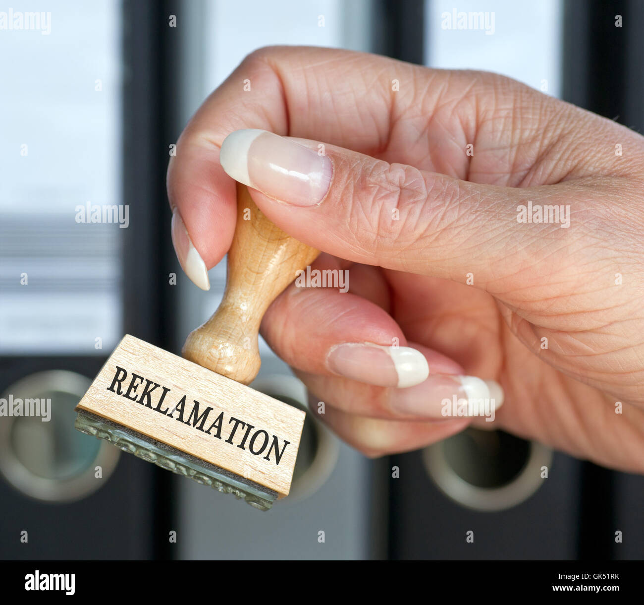 complaints - stamp with hand in the office - Stock Image