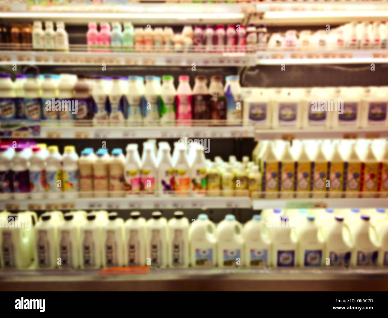 blurred image background with bottle of milks In the mall - Stock Image