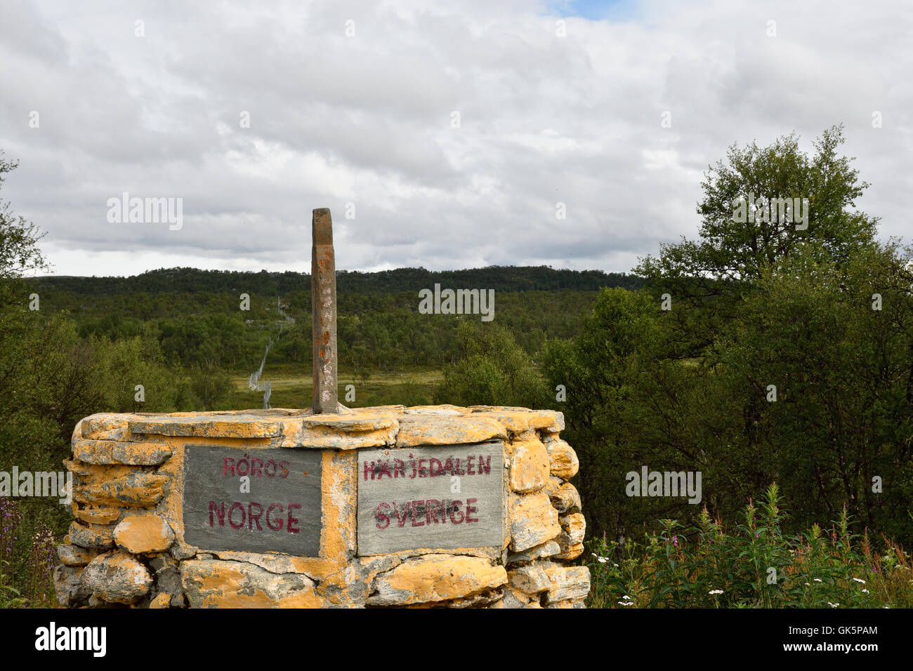 Stone on the border between Norway and Sweden in the North. - Stock Image