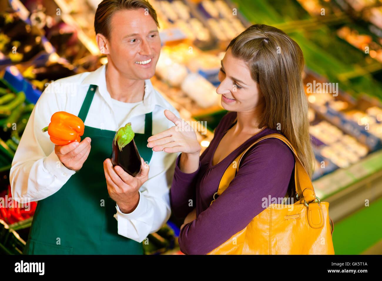 supermarket salesman salesperson stock photo 115069286