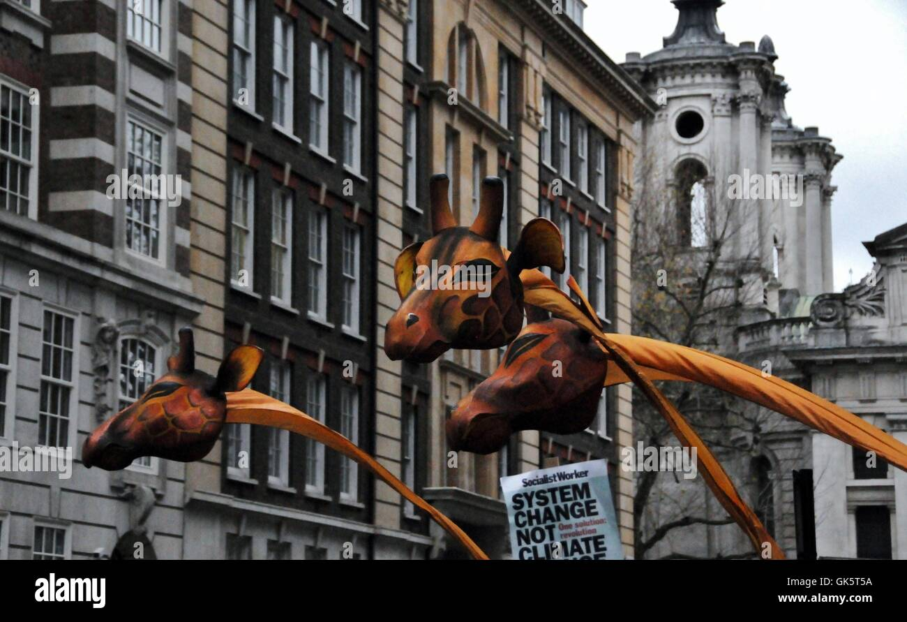 A Giraffe puppet, at The People's Climate Change March, in London. - Stock Image