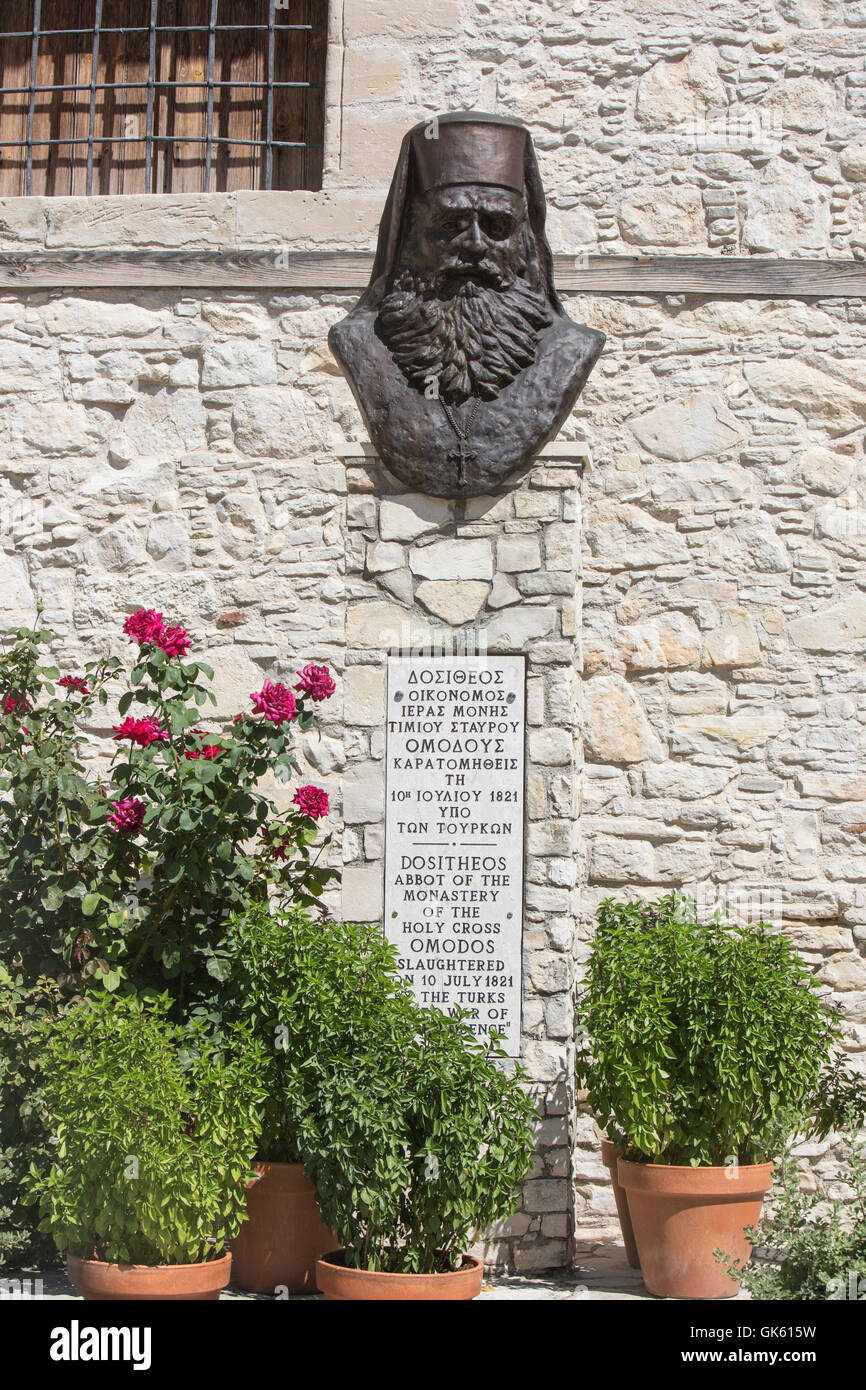 A view of the plaque and bust outside the Church of the Holy Cross in the Monastery of Stavros in Omodos, Cyprus. - Stock Image