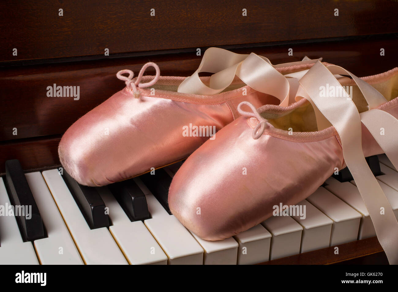 Ballet Shoes On Piano Keys - Stock Image