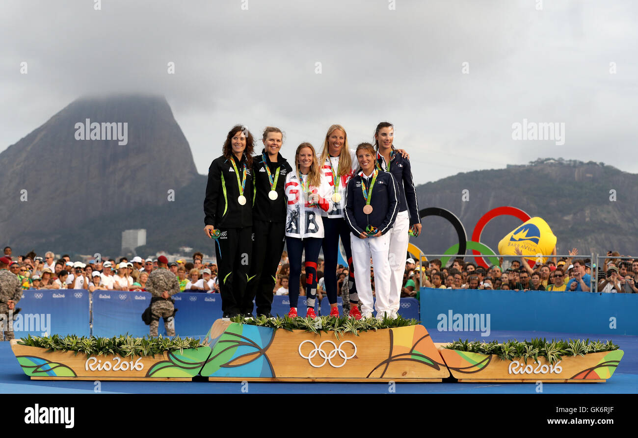 65d74fd8a274 Great Britain s Hannah Mills (centre left) and Saskia Clark (centre right)  with celebrate on the podium with their gold medals alongside silver  medallists