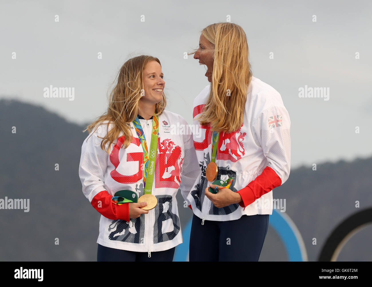 2acfd8171d14 Great Britain s Hannah Mills and Saskia Clark (right) celebrate on the  podium with their gold medals from the Women s 470 Race at Marina da Gloria  on the ...