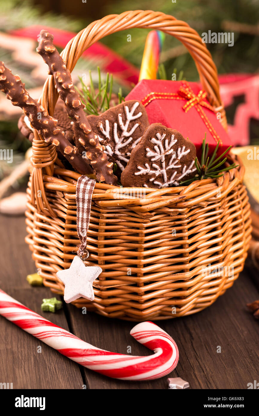festive basket of gifts and christmas decorations closeup