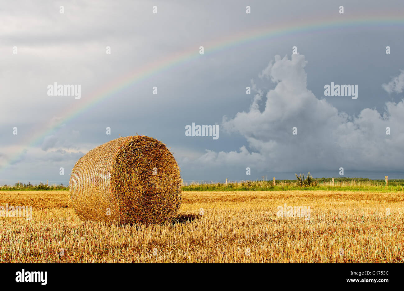 rainbow stormy country - Stock Image