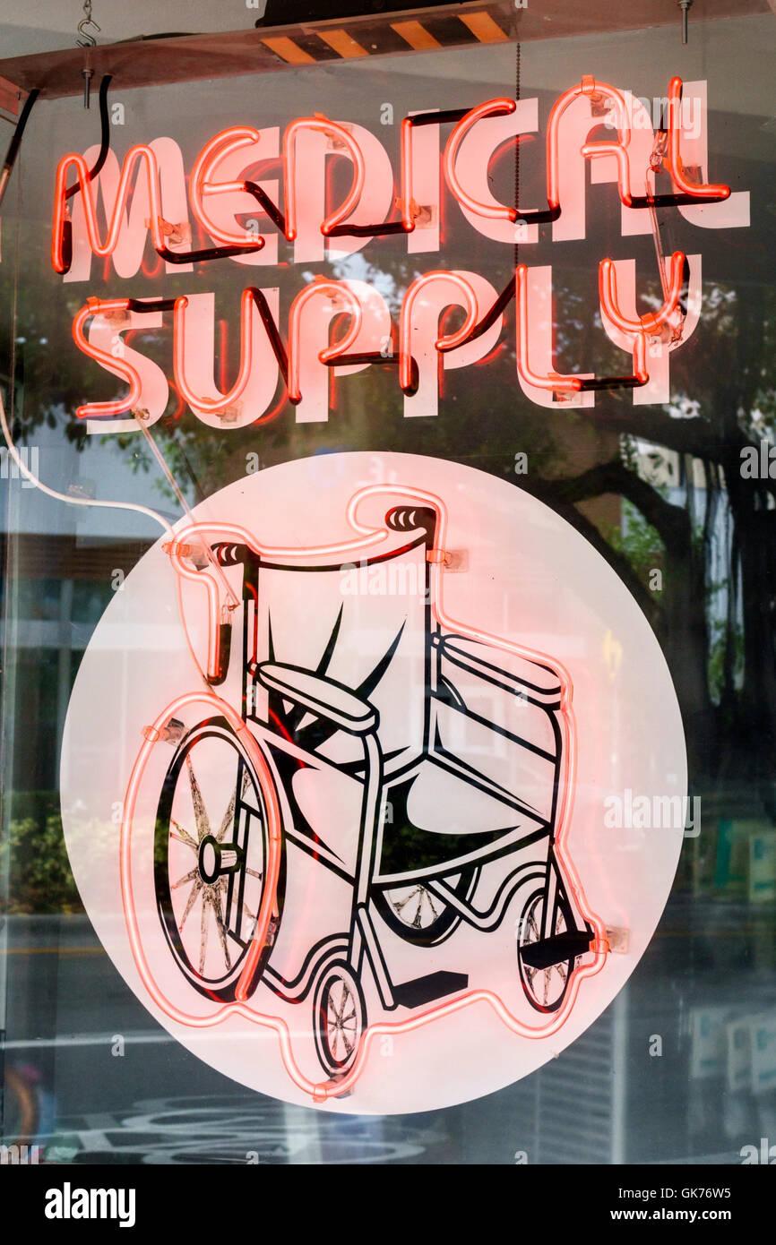 Miami Florida Coral Way shop medical supplies health wheelchair neon light ad advertisement durable Medical Equipment - Stock Image
