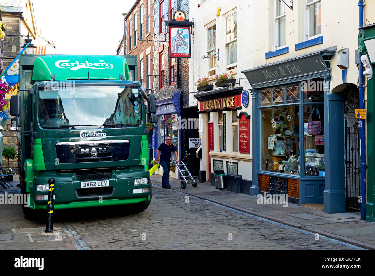 Carlsberg lorry parked on cobbled street outside pub, the Black Horse, Whitby, North Yorkshire, England UK - Stock Image