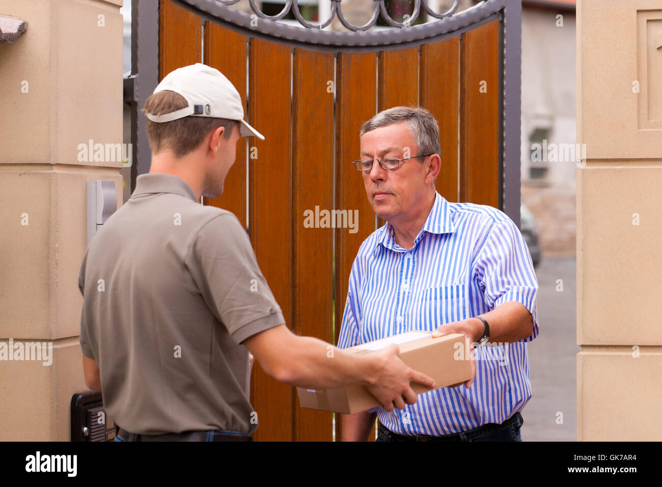 postal service - delivery of a package - Stock Image