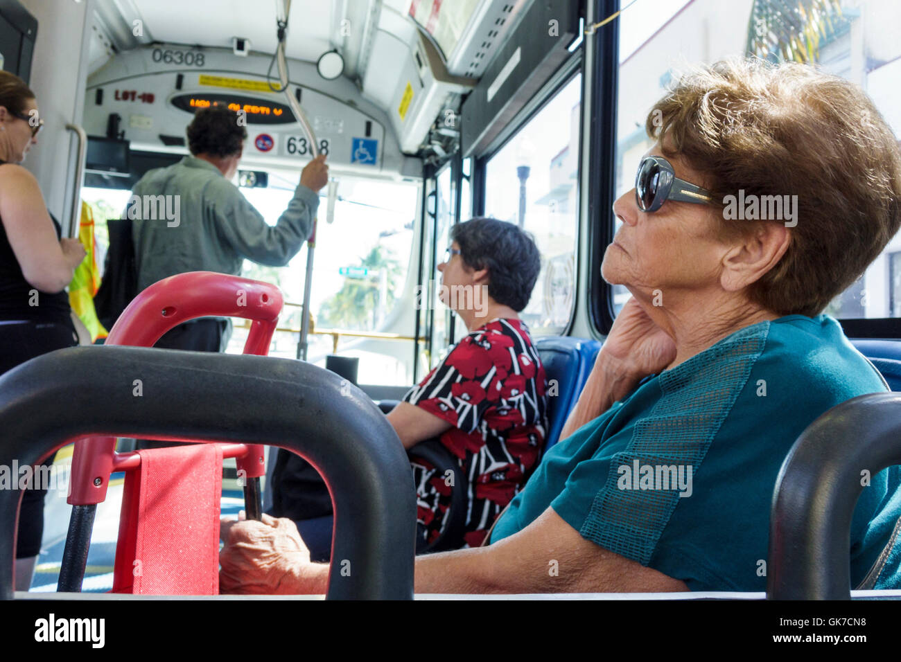 7ea588ccaaf Miami Florida Beach South Beach Local Miami Dade Metrobus mass transit  public transportation bus Hispanic woman