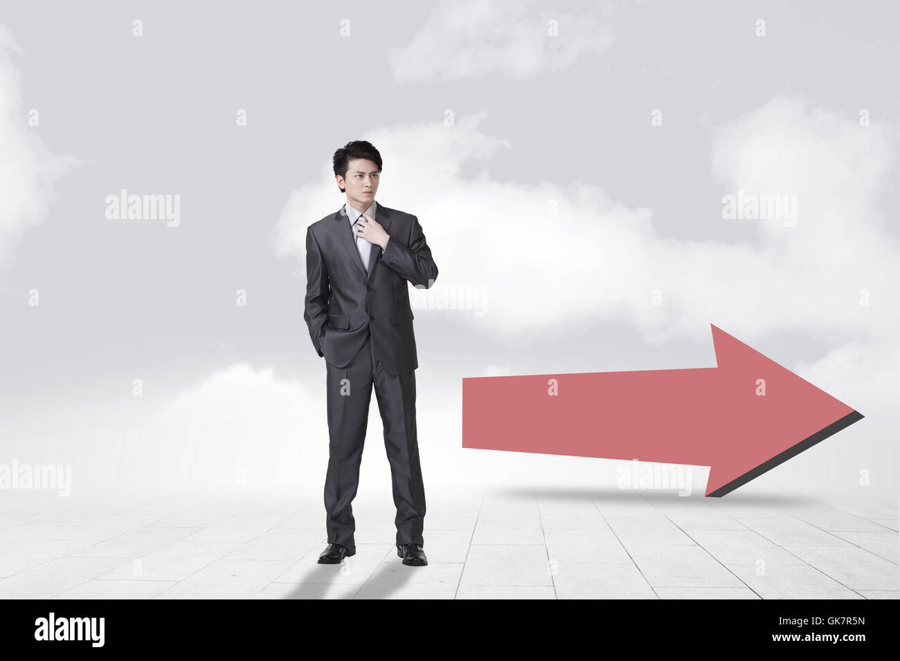 Young business man and arrow symbols - Stock Image