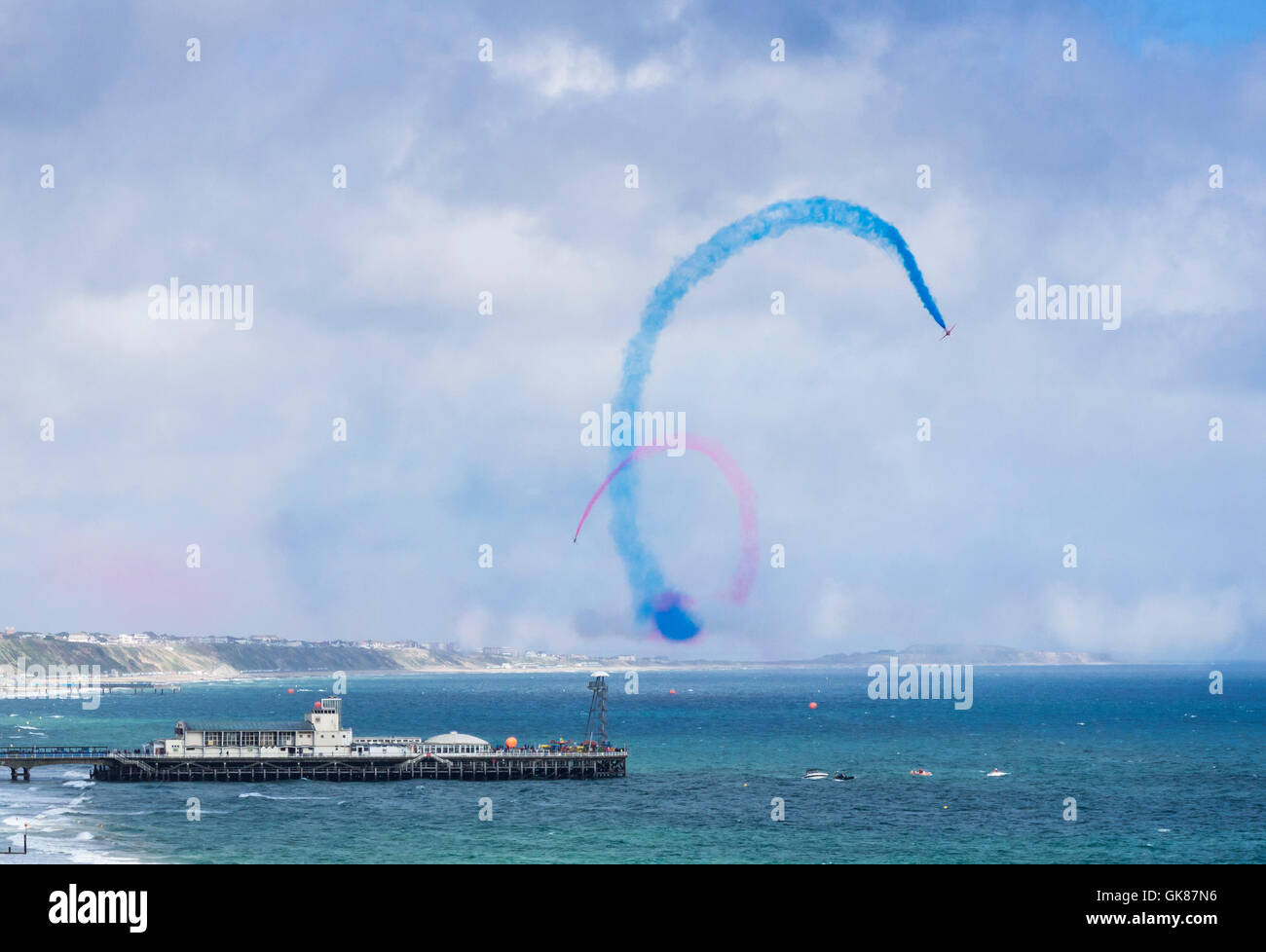 The Red Arrows, the Royal Air Force Aerobatic Team displaying their skills over Bournemouth and Poole Bay, Dorset, - Stock Image