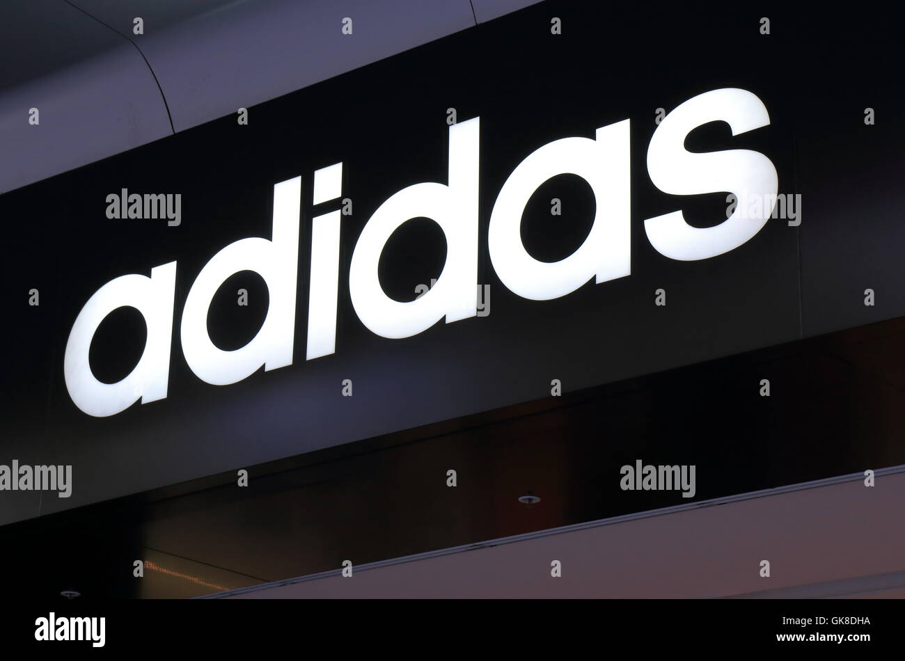 Logo of Adidas, German multinational corporation that designs and manufactures sports clothing and accessories. - Stock Image