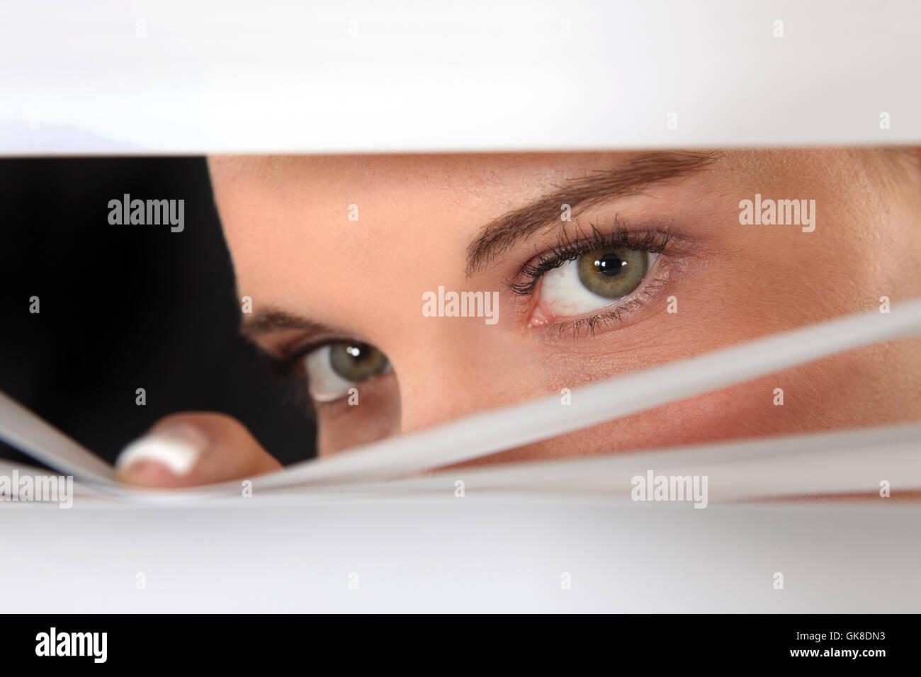 female eyes distrustful - Stock Image