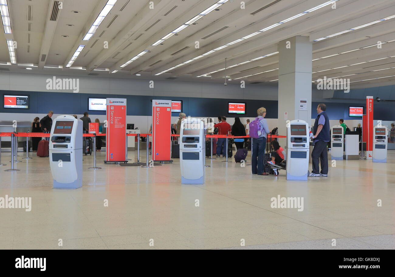 People queue at Melbourne Airport Qantas check in counter in