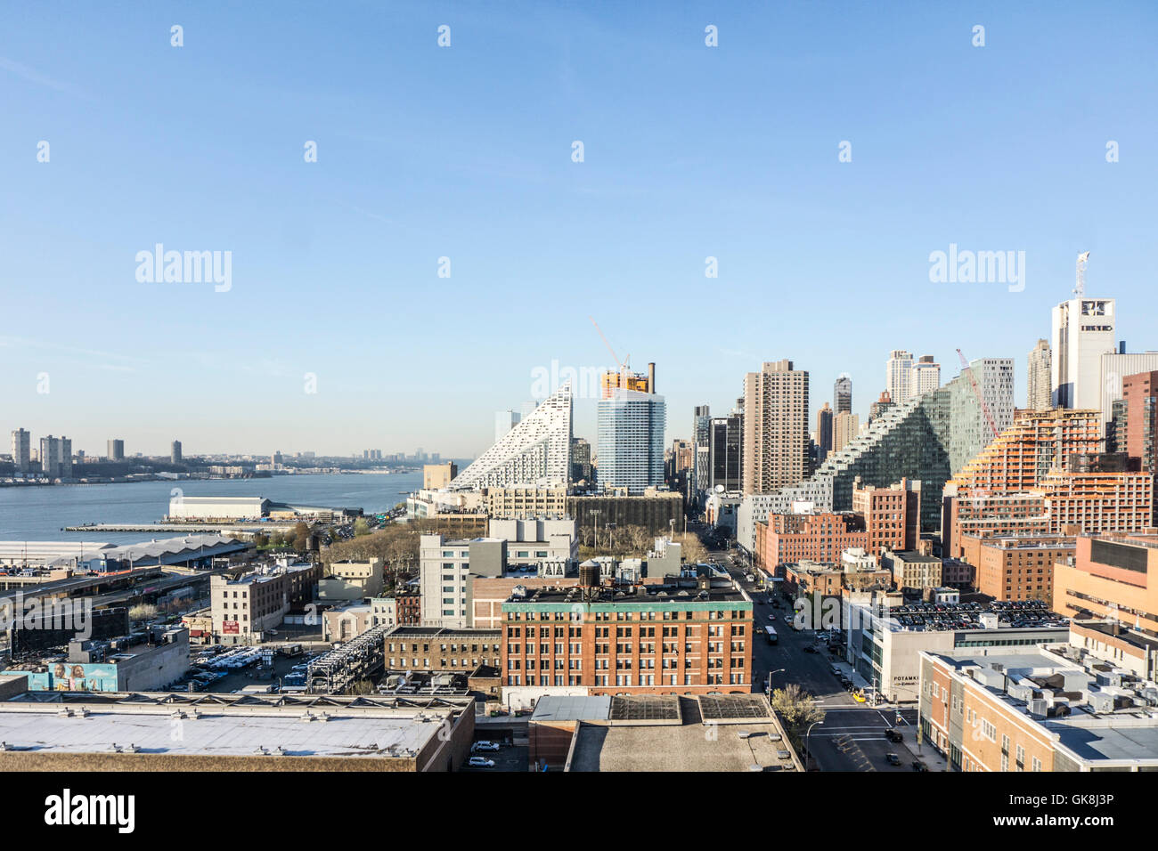 view north to new high rise residential towers overwhelming west side & threatening attempts to change Clinton - Stock Image