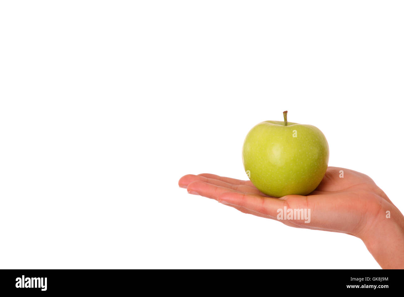 green apple in woman's hand Stock Photo