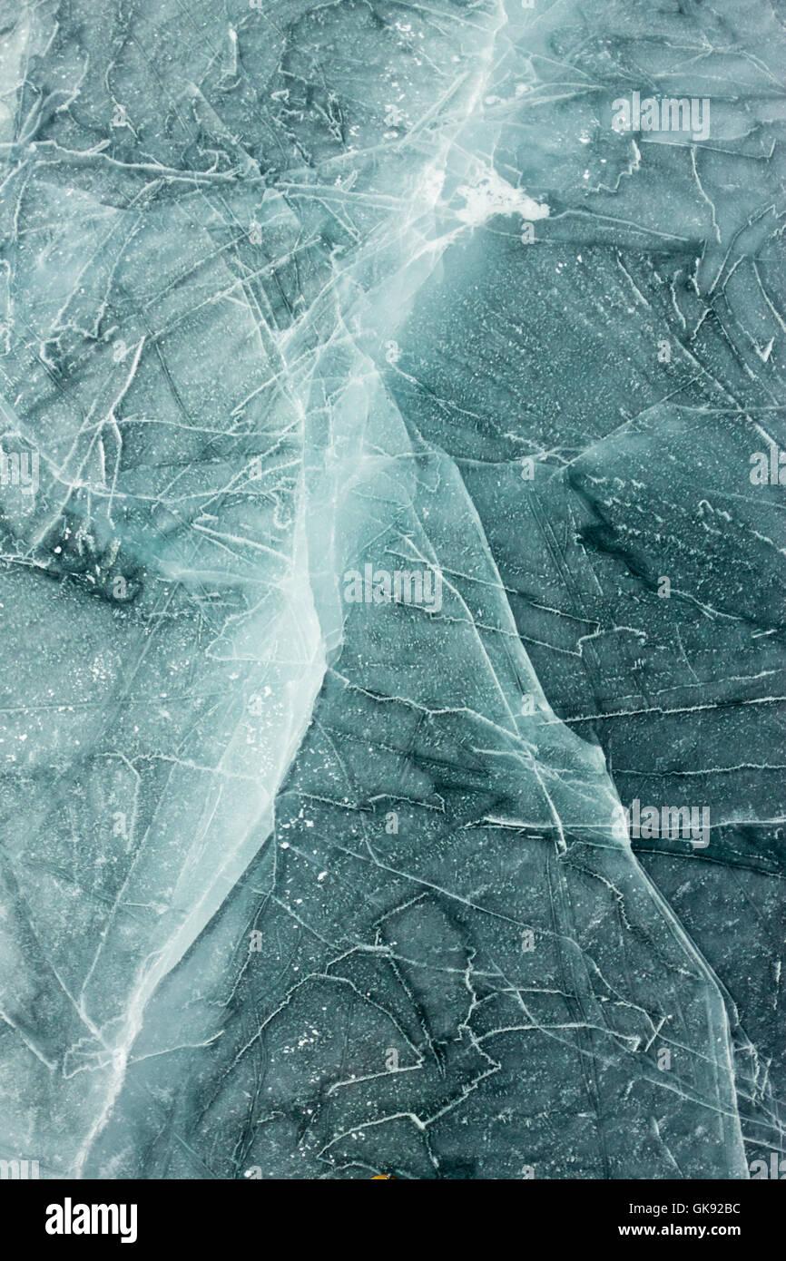 The pattern of cracks on blue ice of Lake Baikal - Stock Image