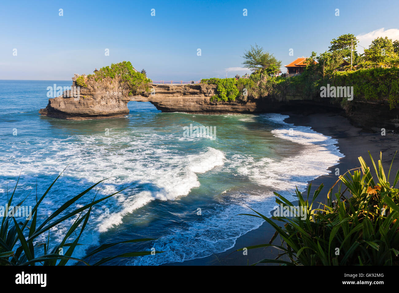 Pura Batu Bolong temple on the beatiful rock in the morning light, Tanah Lot, Bali, Indonesia. - Stock Image