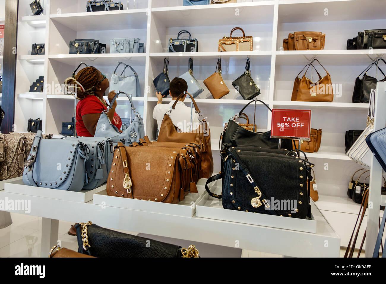 eed253464f93 Florida Ellenton Ellenton Premium Outlets mall shopping center business  retail Michael Kors outlet store women s handbags designer brand retail  displa