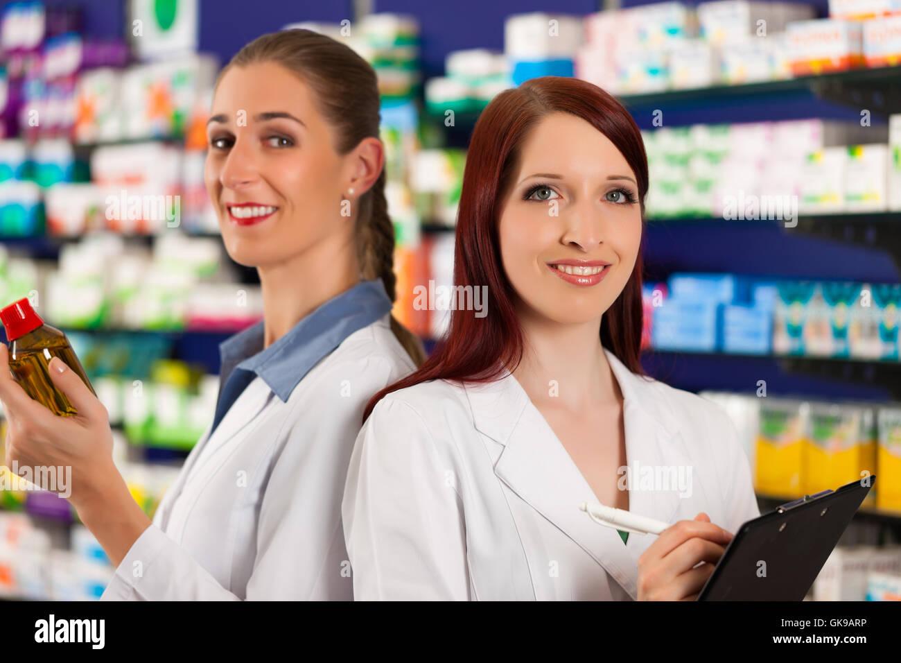 pharmacist team in pharmacy drugs - Stock Image