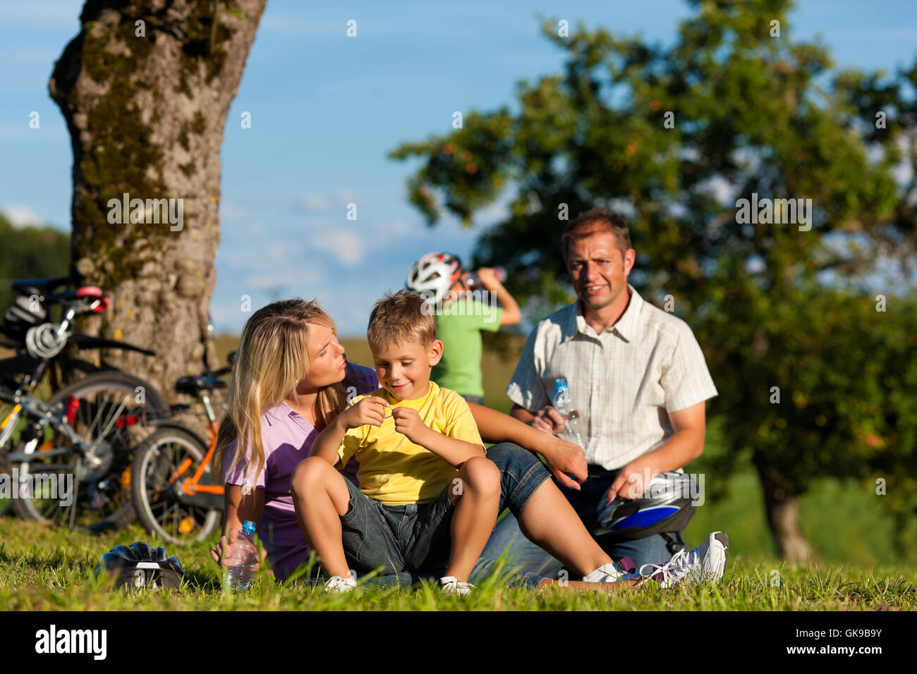 family makes a bike ride - Stock Image