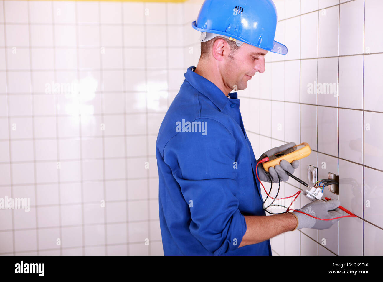 wall tile electrician - Stock Image