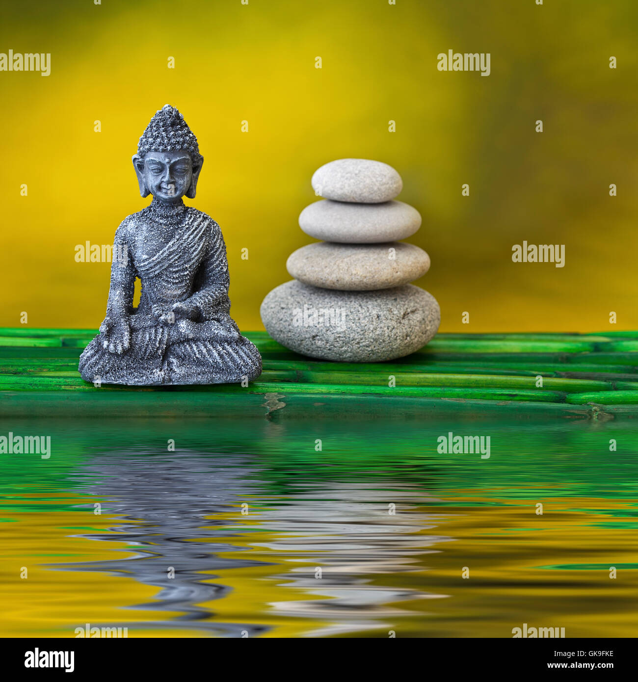 buddha and stone tower - Stock Image