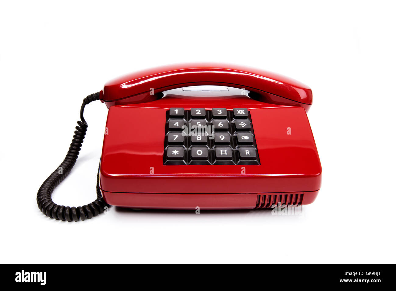 classic red telephone from the eighties - Stock Image