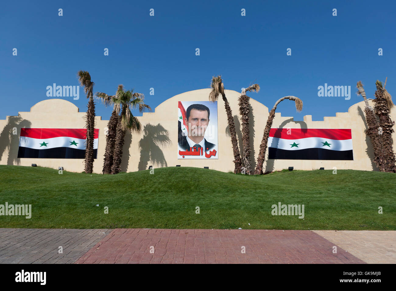 portrait of bashar al-assad on a sidewalk in syria - Stock Image