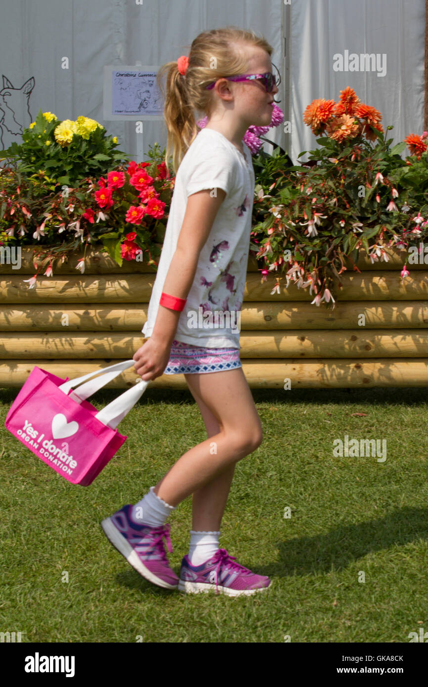 Young Evie Pownall, a young girl 6 years old carrying pink bag recommending registering for organ donation, Southport, - Stock Image