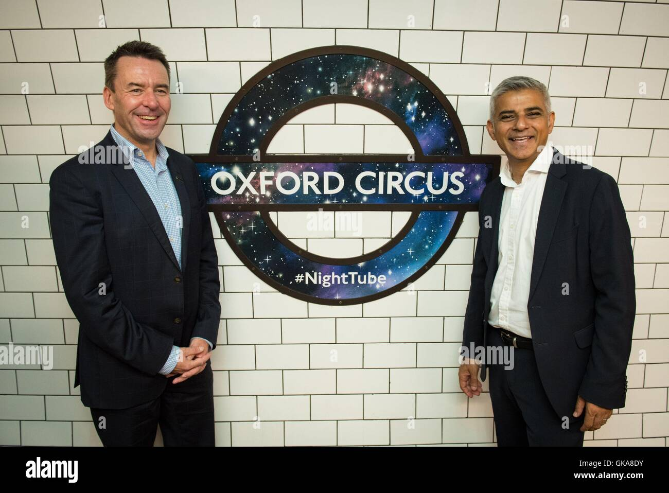 Transport for London Managing Director Mark Wild (left) and Mayor of London Sadiq Khan with a new Night Tube logo - Stock Image