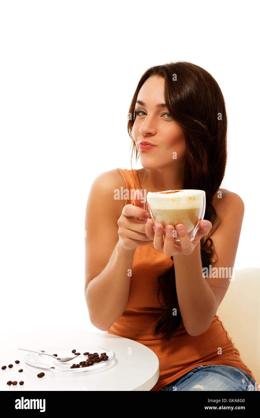 coffee young crafty woman with a cup cappuccino - Stock Image