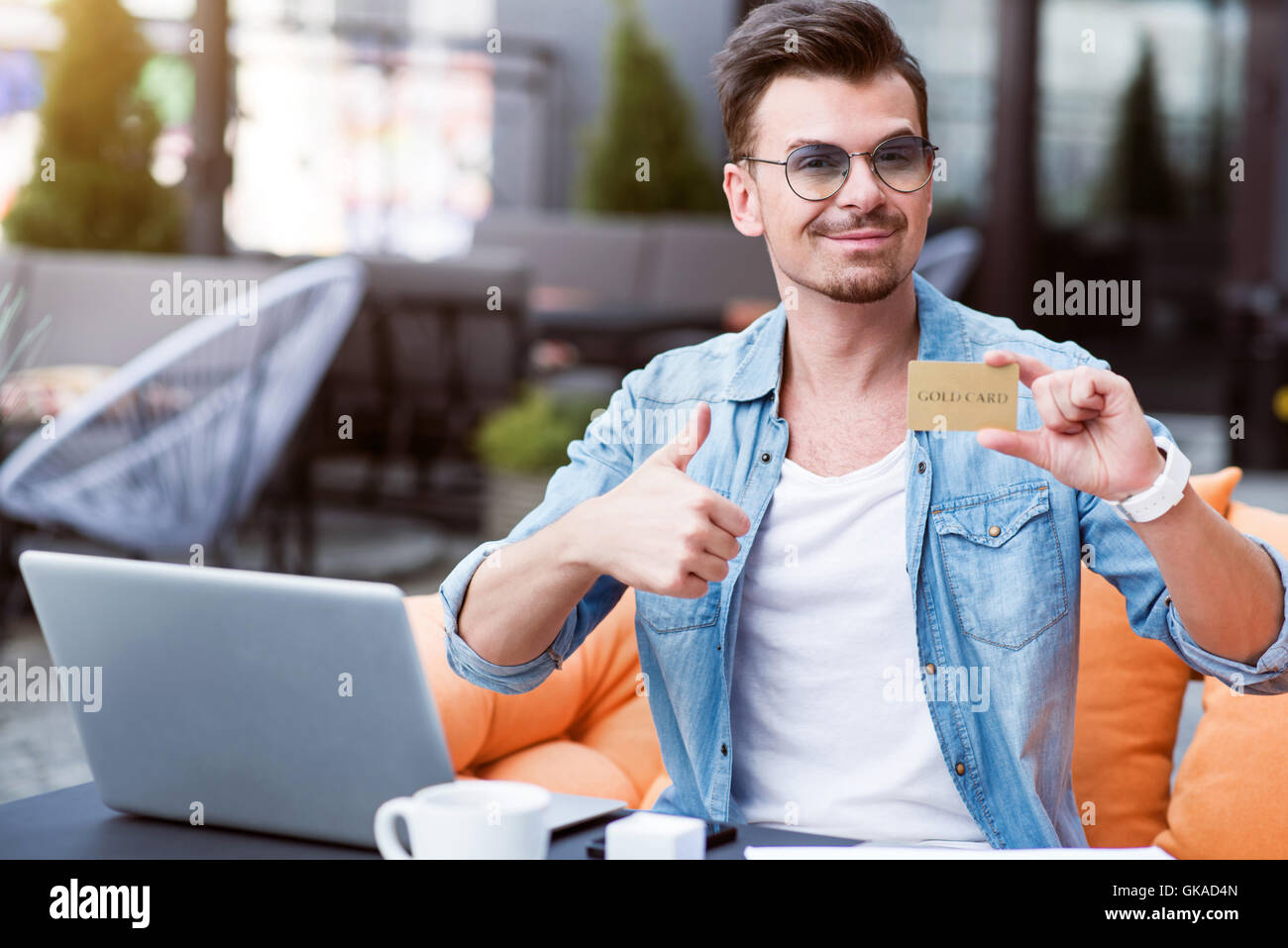 Positive man sitting in the cafe - Stock Image